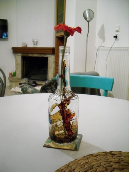 Flower buds inspired painted glass bottle as a centerpiece.
